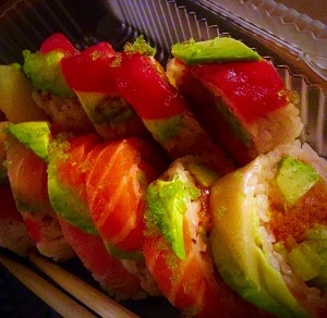 Spicy salmon, avocado, cucumber in soy paper, with assortment of fresh fish, tobiko on top (12pc)